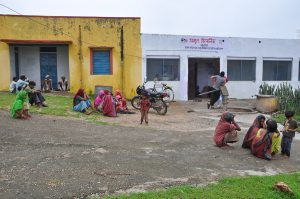 Image of patients waiting to seek consultation outside AMRIT Clinic, Manpur