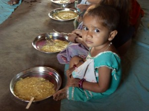 A child takes a meal in the Amrit creche program