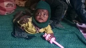 A baby plays in the Amrit creche