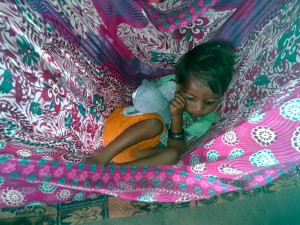 A child sleeps in a jhula