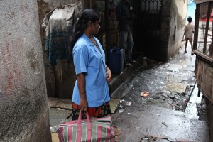 A community worker for SNEHA stands in an alleyway in Dharavi, Mumbai. (Photo credit: SNEHA Stock Photos)