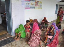 Image of patients awaiting treatment outside the AMRIT Clinic in Manpur